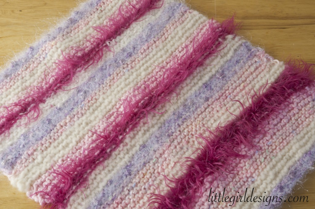How to Knit a Baby Doll Blanket - an easy tutorial on how to knit a baby doll blanket using leftover yarn scraps. @littlegirldesigns.com