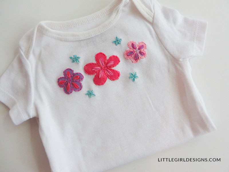 A personalized baby gift painted embroidered onesie